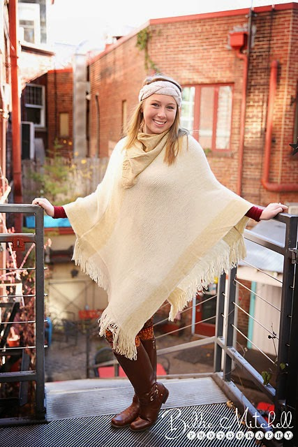 senior girl wearing white knit shawl and headband, with gold scarf and brown boots