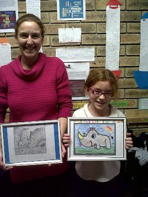 The Grade 8 Teacher with the winning drawing and the winner of the Colouring-In competition.