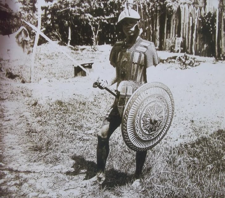 A Muslim warrior in ancient Philippine Muslim Battle Gear with ancient shield and sword