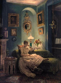 A Victorian woman reads in a blue room.