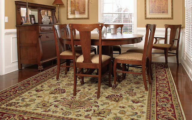 An area rug enhances the look of this dining room