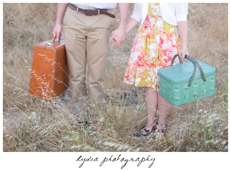 Bride's and groom's feet and luggage and basket at lifestyle engagement portraits in the Bay Area of California