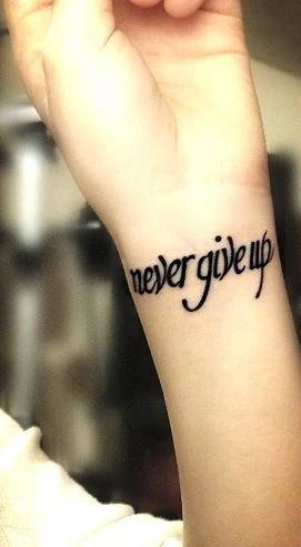 pics for never give up tattoo on arm. Black Bedroom Furniture Sets. Home Design Ideas
