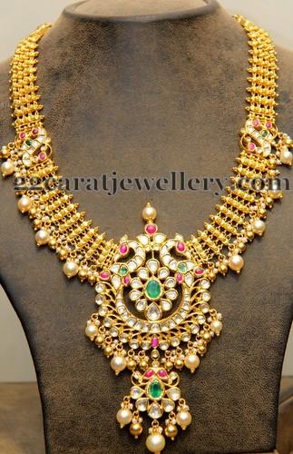 Gold Classy Haram With Trendy Locket Jewellery Designs