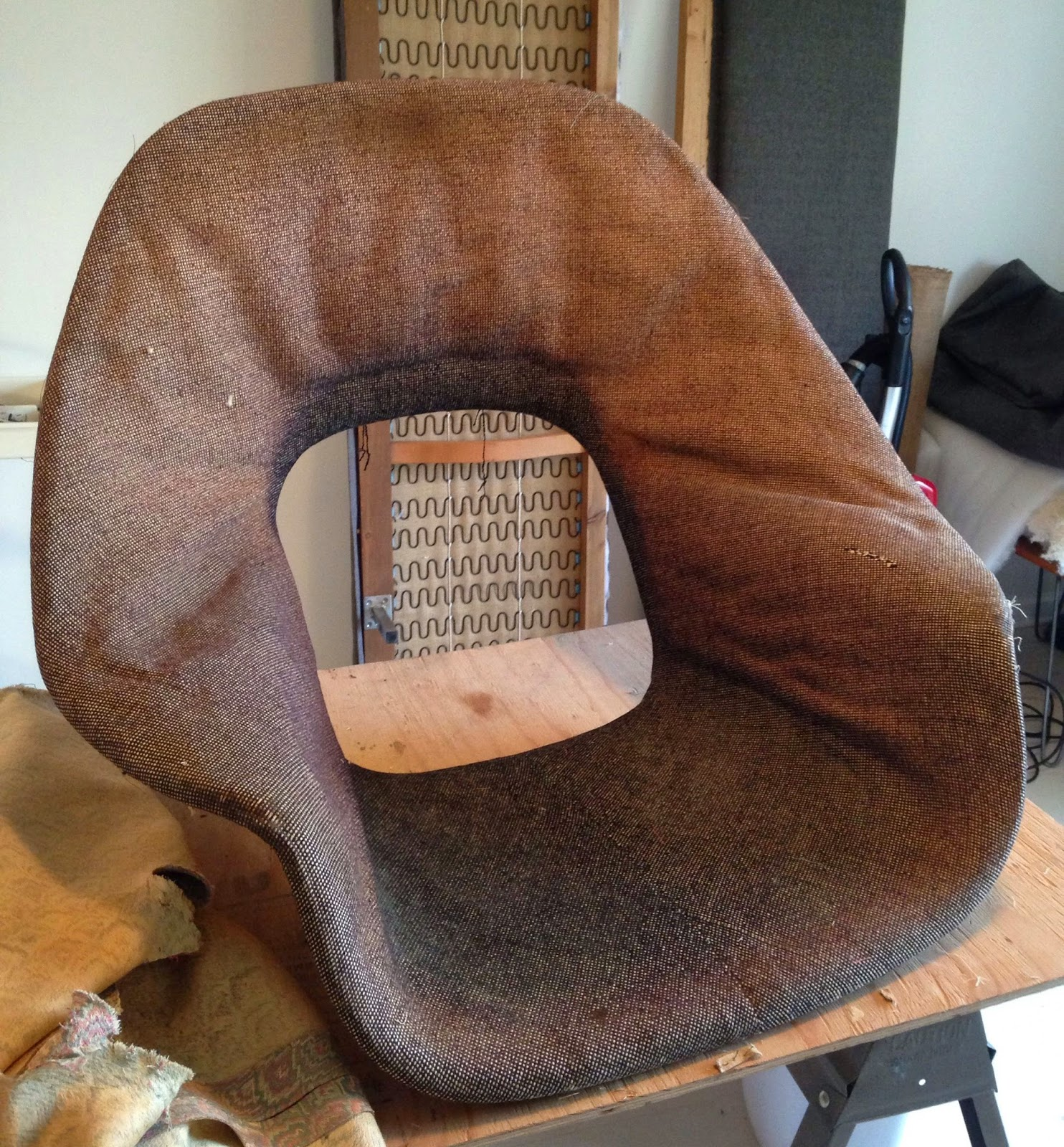early 1960s Womb chair by Eero Saarinen for Knoll  It had been  reupholstered in a hideous pink fabric and all of the foam and cushions  were dehydrated Remnant  Before   After  Womb Chair. Eames Wicker Womb Chair. Home Design Ideas