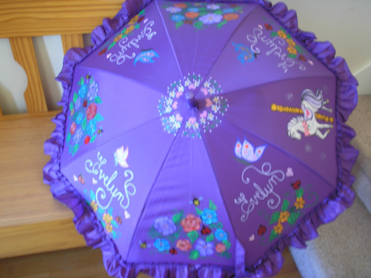 purple Evelyn parasol with carosel horse