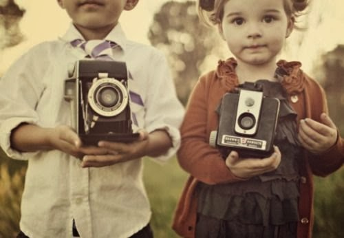 picture of children holding cameras