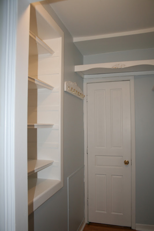 left side of the cupboard. I built a tie rack and shelves for storage title=