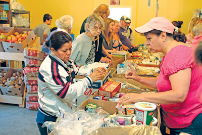 Food banks feel pressure from food stamp cuts