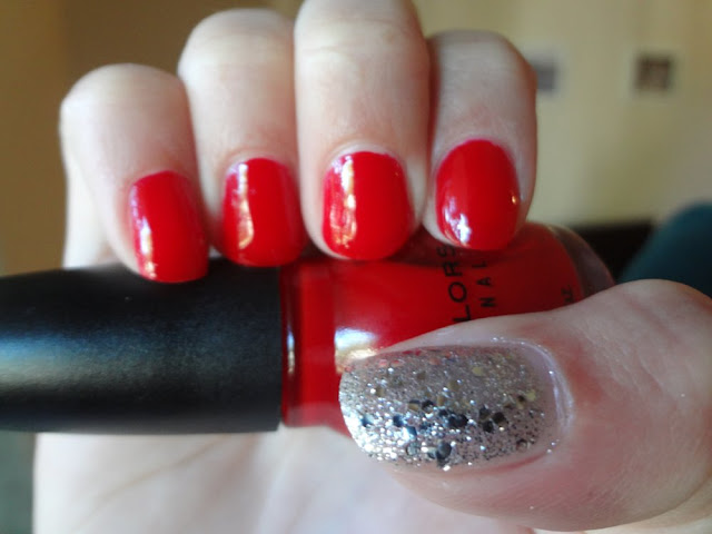 red nails with silver glitter accent