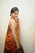 Madhumitha sizzling pics in saree-thumbnail-12