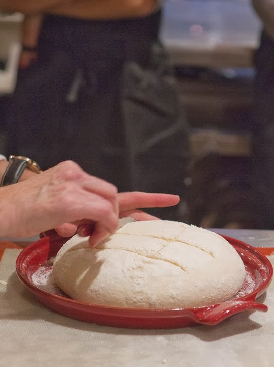 dough being scored for rustic white bread