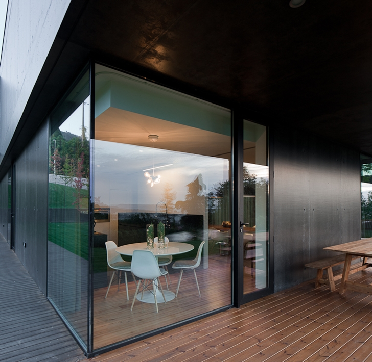 Glass corner wall in Black Concrete House by Pitagoras Arquitectos