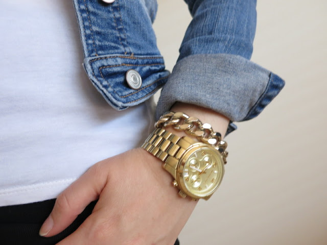 Gold watch and gold chain bracelet.