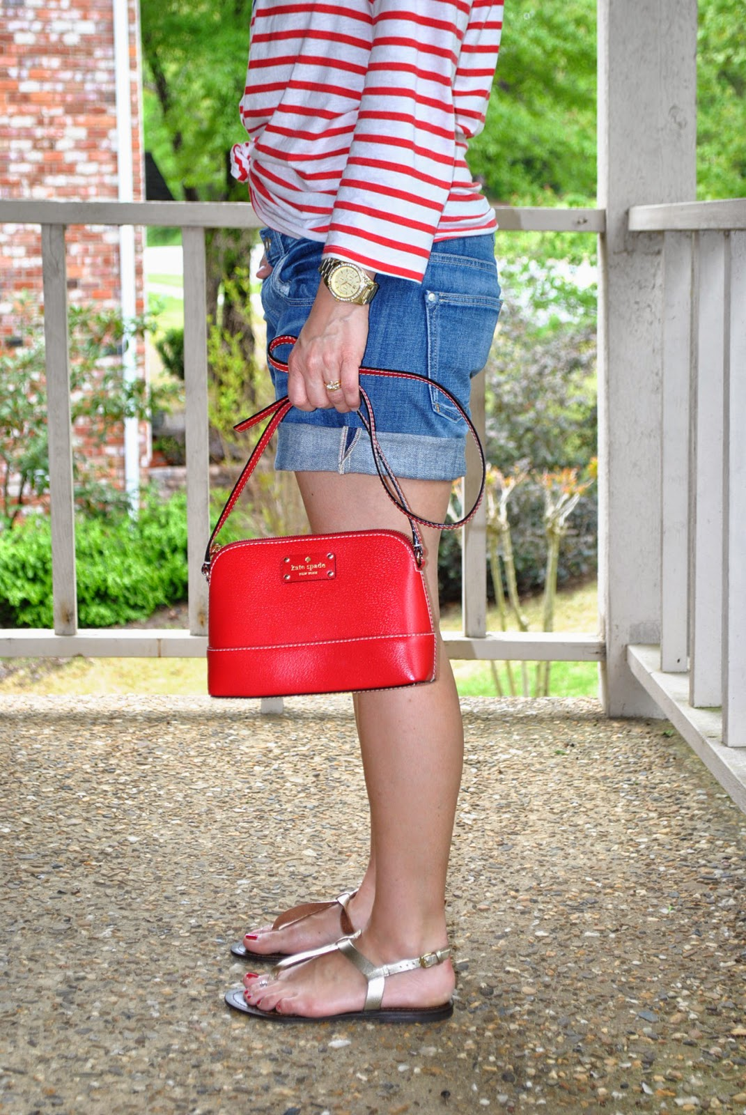 Target Merona fedora hat, J crew Sunglasses anthropologie sundry weekend tee, anthropologie denim shorts, red crossbody, gold sandals how to style denim shorts