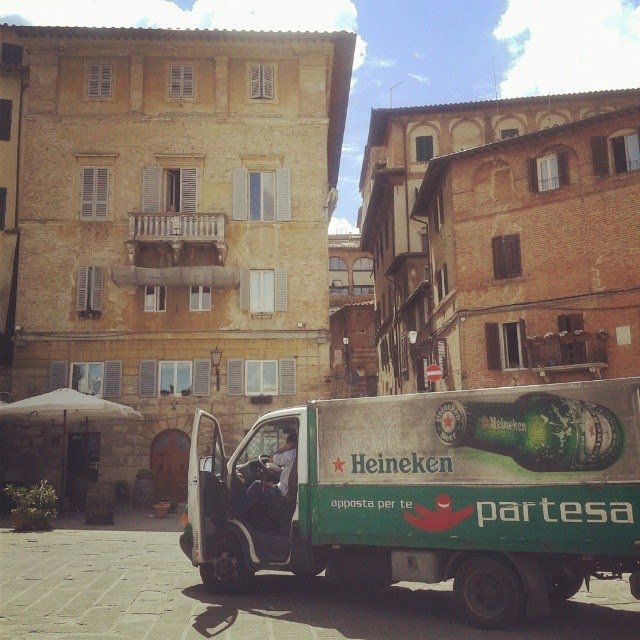 A driver of a Heineken truck having a Siesta in Siena