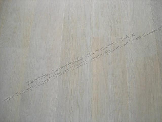Βάψιμο ξύλινων πατωμάτων με λευκό χρώμα