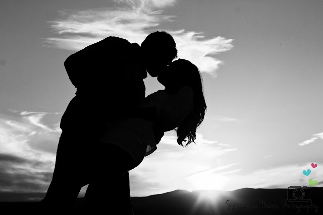 silhouette of couple dipping