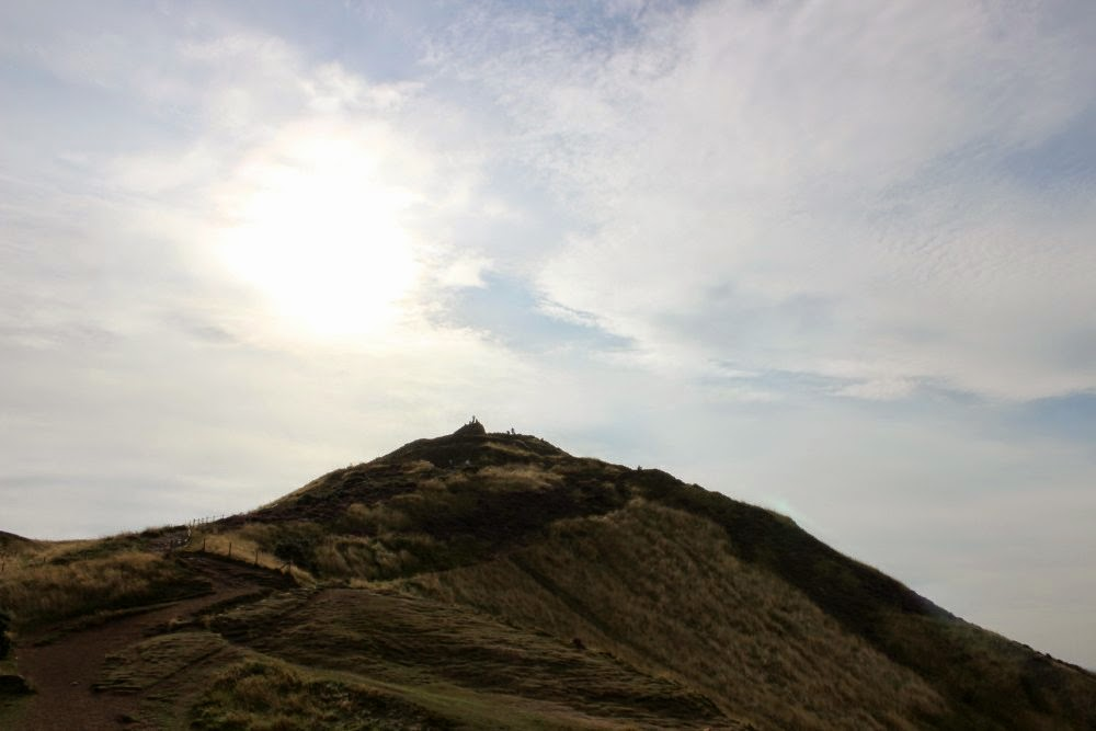 arthur's seat top with sun behind it, edinburgh, scotland