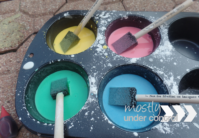 Close up of colored cornstarch and water for diy chalk paint - yellow, red, blue and green