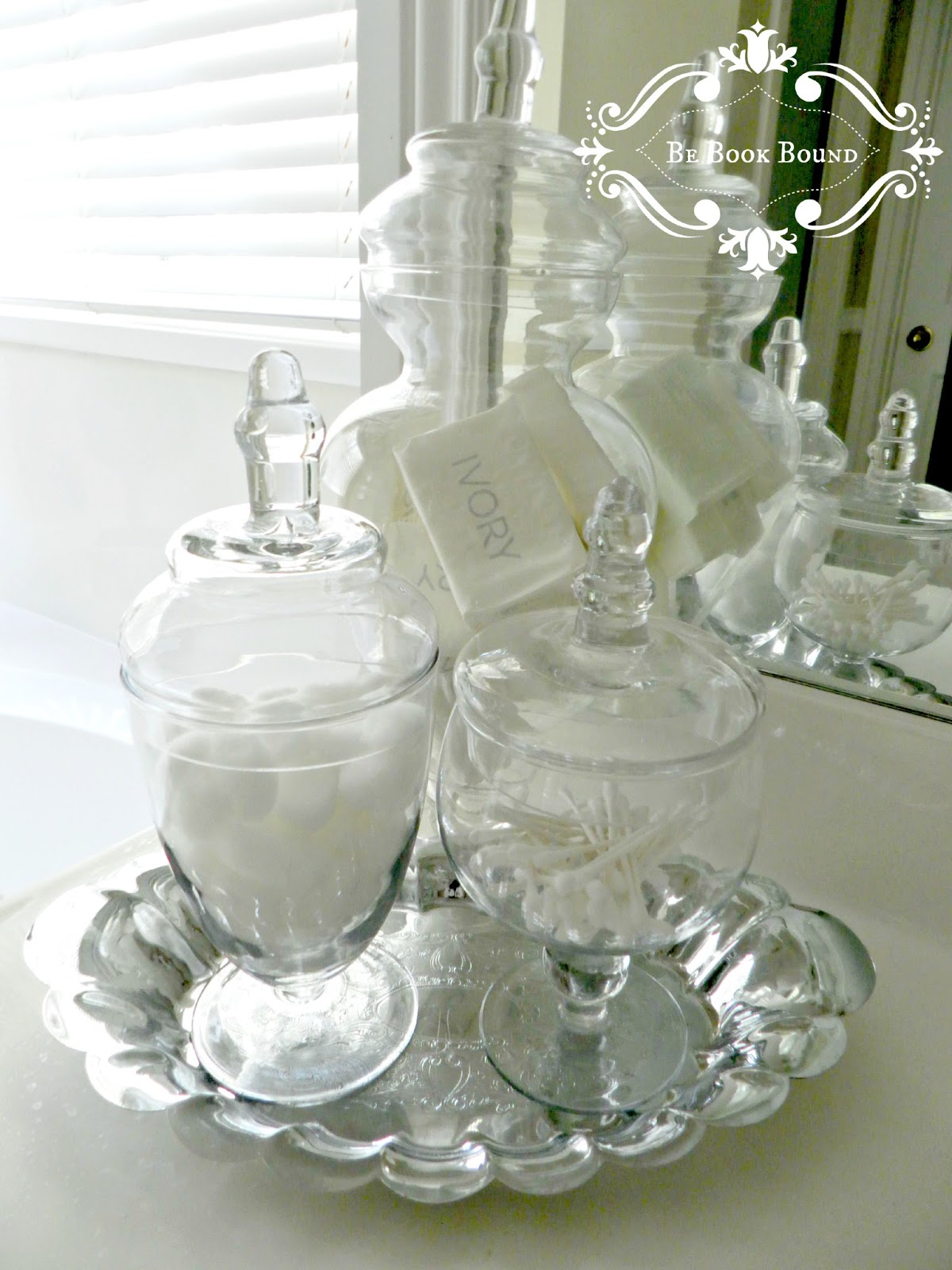 I added apothecary jars on silver trays for a little sparkle. Be Book Bound  From the Design Book  A Bathroom Makeover