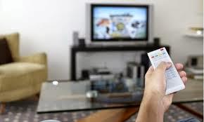رجل يشاهد تليفزيون - يمسك ريموت كنترول - man watch tv hold remote control