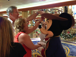 Mike and Gena feeling Mickey's costume