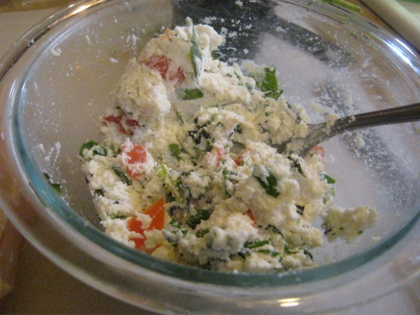 Mix together the ricotta, spinach, tomatoes,Parmesan cheese, basil ...