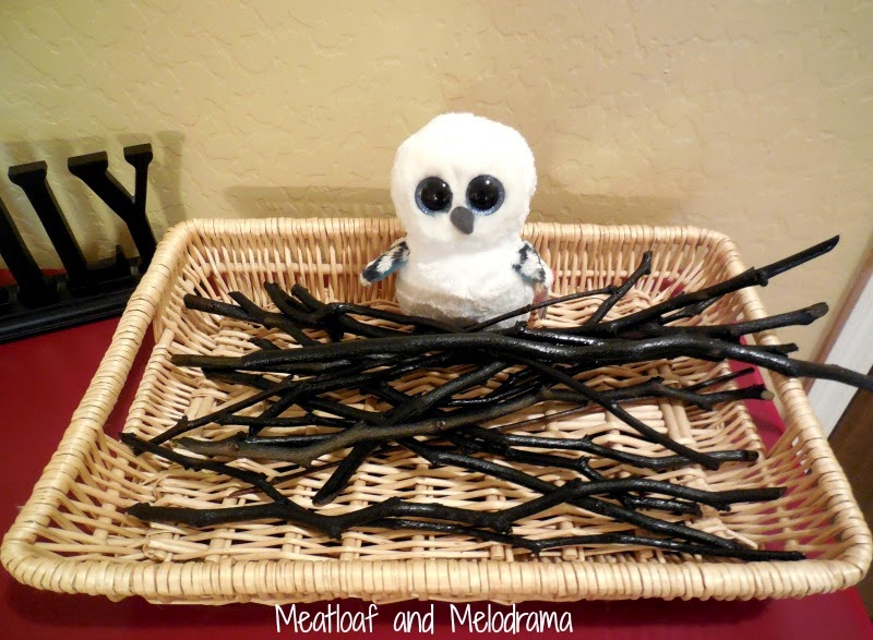 wands made of twigs spray painted black and stuffed owl