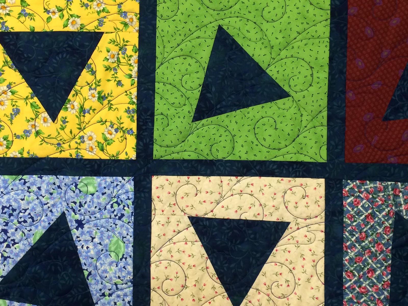 Kim Scott Scrappy Triangle Quilt