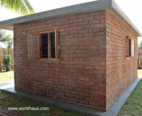 Casa de bajo costo hecha de ladrillos y concreto