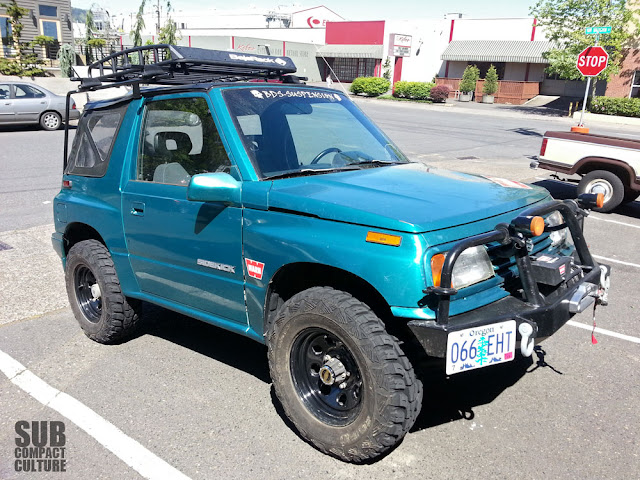 Roof rack on a Suzuki Sidekick soft top.