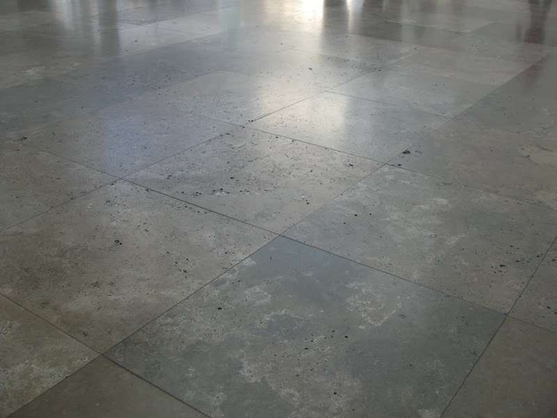 The Getty Museum stone floor with shadows - the inspiration for These Stones Beneath Our Feet by David Ocker