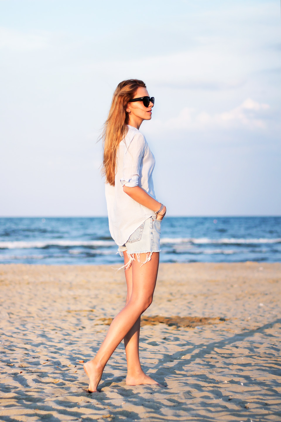 Levi's cutoff shorts, striped button down shirt, Céline Audrey sunglasses