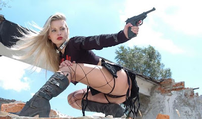 blonde soviet babe with ruger pistol posing nicely in model shoot