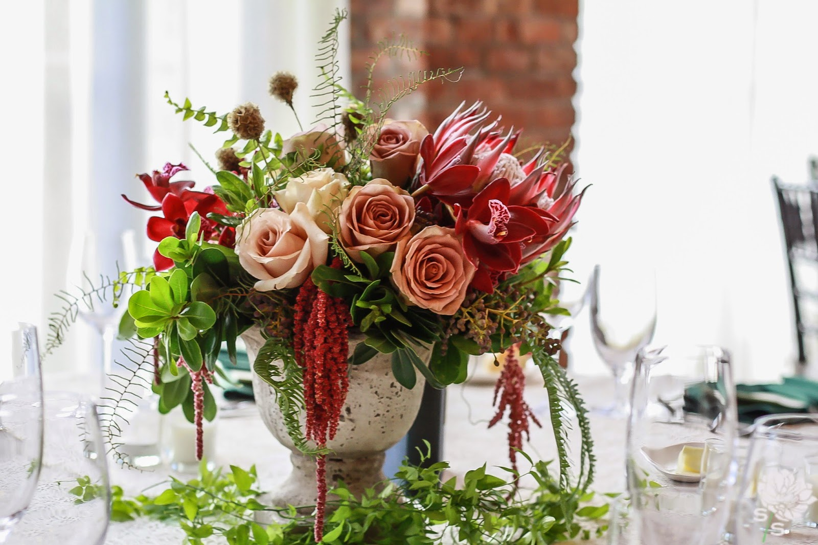 The Roundhouse Wedding - Beacon, NY - Hudson Valley Wedding - Table Centerpiece - Protea, Orchid, Amaranthus - Old Books - Wedding Flowers - Splendid Stems Floral Designs