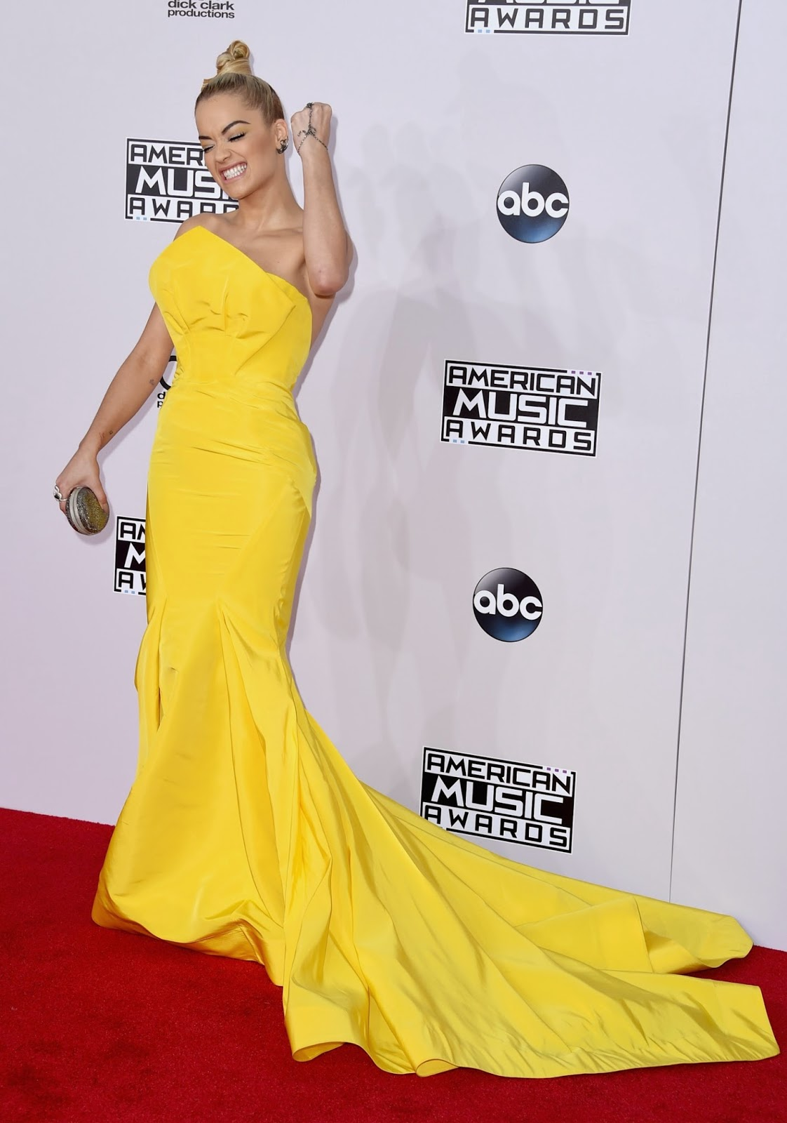 Rita Ora wears a bright yellow Zac Posen gown to the 2014 American Music Awards