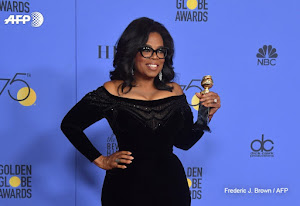 Oprah declares 'new day' for women in campaign-like Globe speech