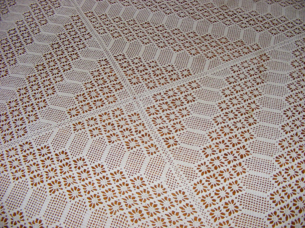 Crocheted lacy tablecloth
