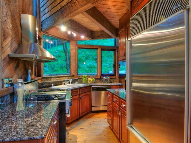 Photo of kitchen inside of tree house in the forest