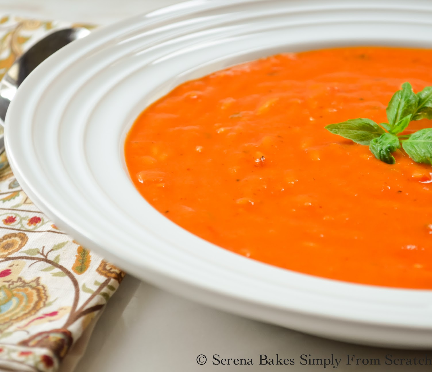 Creamy Roasted Tomato Basil Soup with Orzo is the perfect use for fresh tomatoes and only has 393 calories per generous serving.