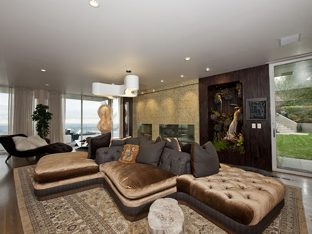 Picture of unusual shaped brown sofa in the modern living room of the guest house