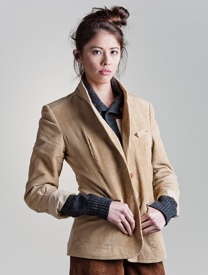 A girl in a corduroy jacket