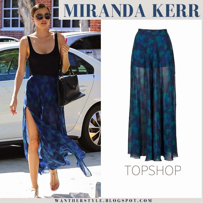 Miranda Kerr in blue maxi print sheer skirt from Topshop and black top gold sandals and sunglasses want her style fashion inspiration