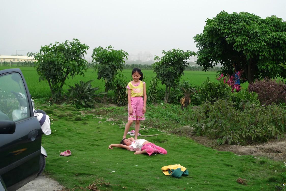 young taiwanese girls playing outside
