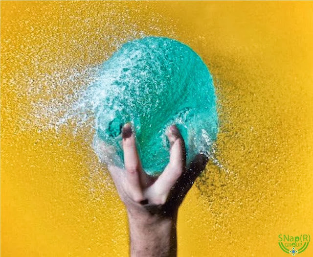 High-Speed Photographs Of Colored Water Bursting Out Of Balloons