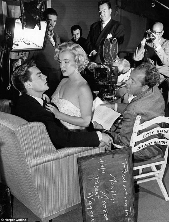 Cute Robert Wagner with a seductive Marilyn Monroe on his lap during a test scene for Let us Make It Legal on June