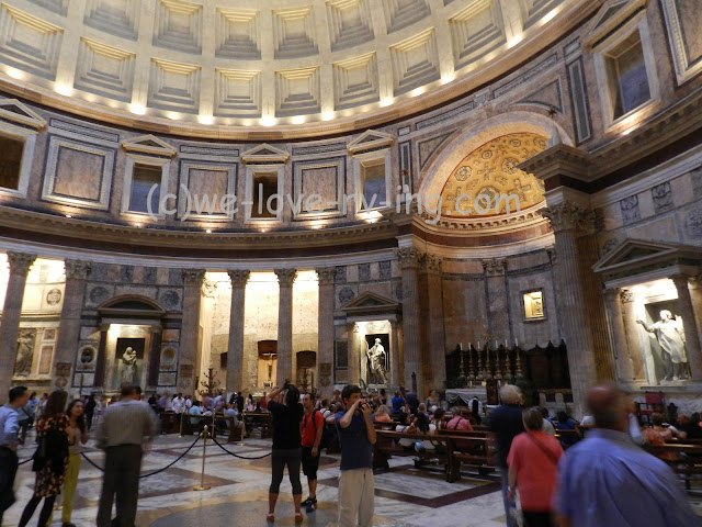 We see the round room filled with people in the Pantheon
