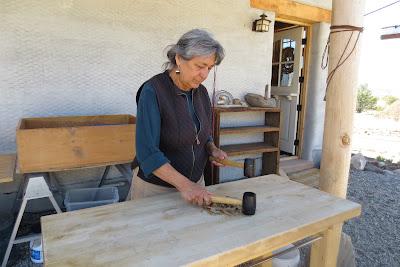 Jacqueline pounds the fiber into pulp