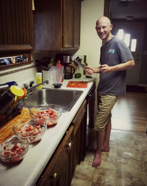 roy slaved away in the kitchen making delicious homegrown salsa